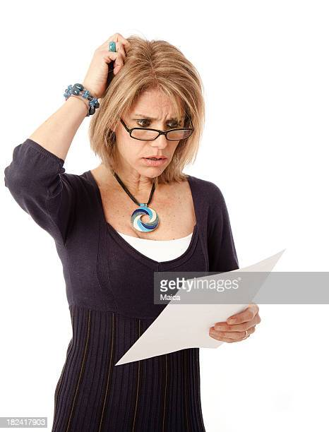 Mature woman shocked by bill or communication