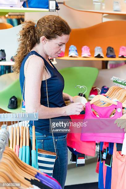 Mature woman shopping for sport clothes