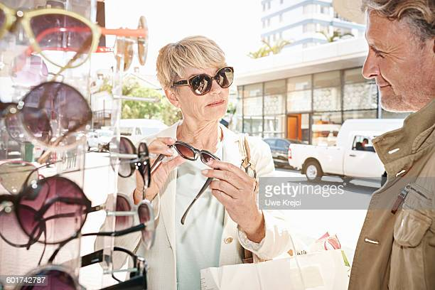 Mature woman shopping for sunglasses