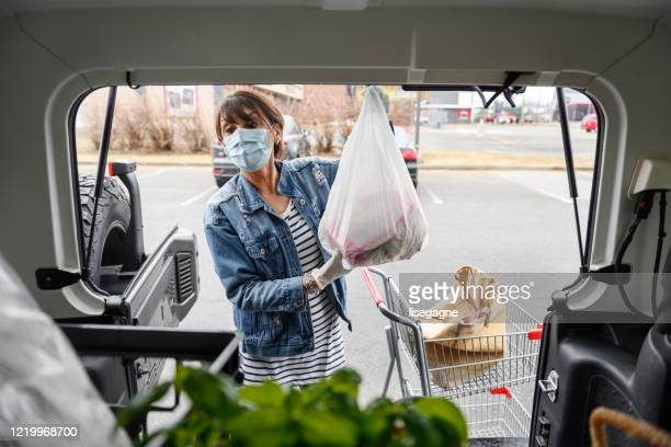 mature woman shopping grocery - illness prevention stock pictures, royalty-free photos & images