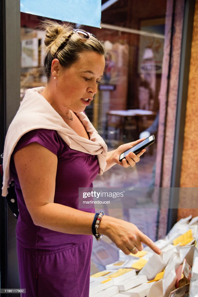 Mature woman shopping in street market outdoors. : Stock Photo