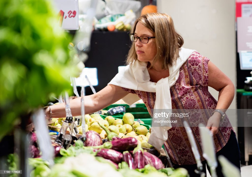 Mature woman shopping in supermarket. : Stock Photo