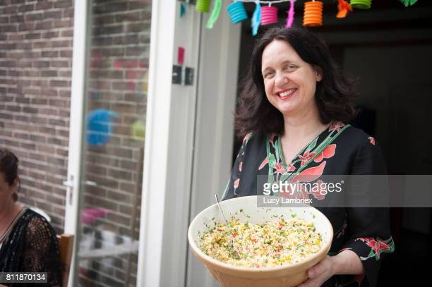 Mature woman showing couscous salad