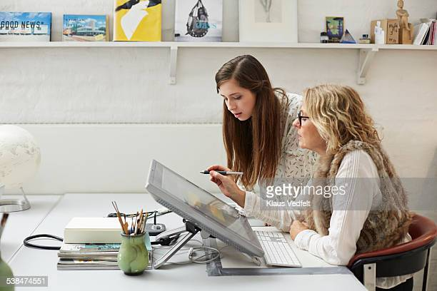 mature woman showing intern graphics on screen - trainee stock pictures, royalty-free photos & images