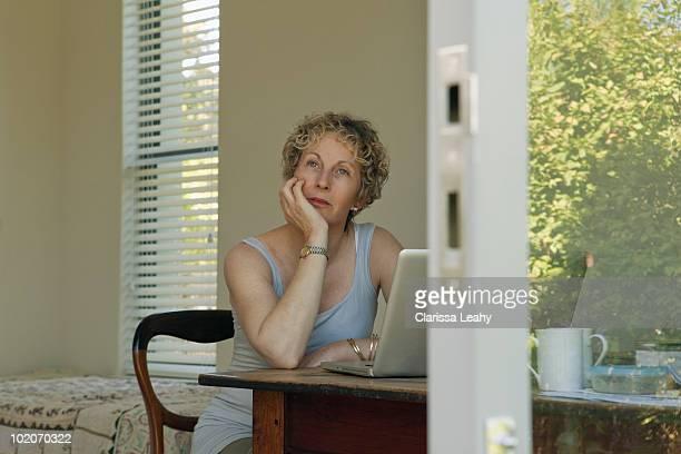 Mature woman sitting at desk
