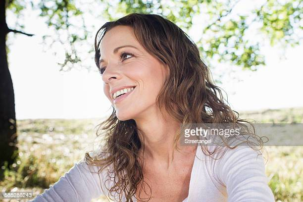 Mature woman sitting in park