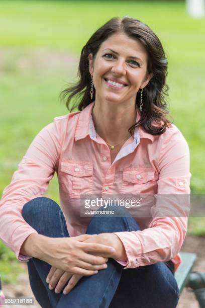 Mature woman sitting in the park