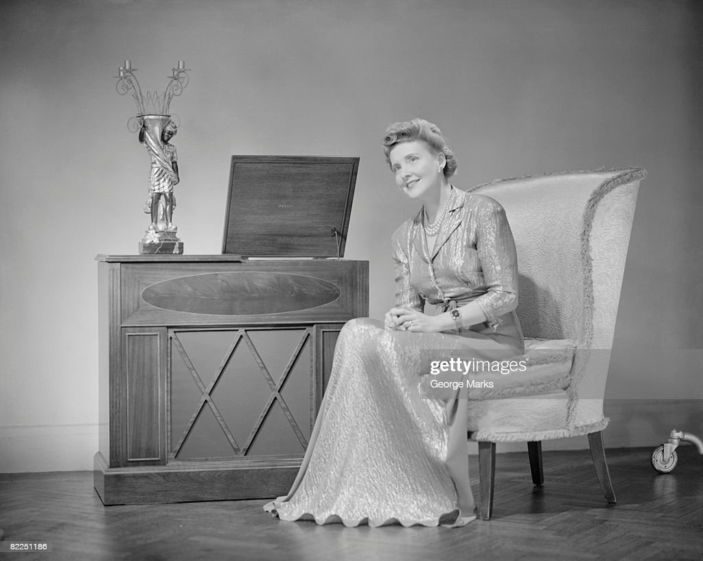 Mature woman sitting on chair, portrait : Stock Photo
