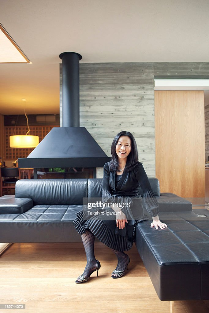 Mature woman sitting on sofa,  portrait : Stock Photo