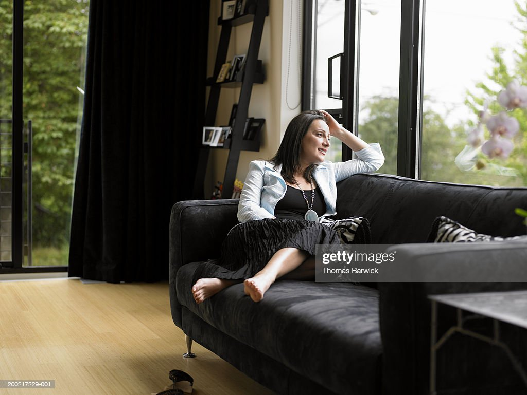 Fabulous Mature Woman Sitting On Sofa Resting Head On Hand Looking Squirreltailoven Fun Painted Chair Ideas Images Squirreltailovenorg