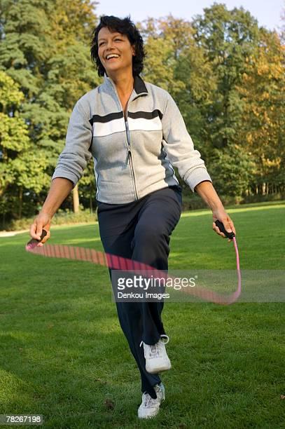 A mature woman skipping.