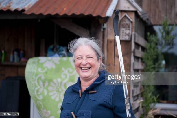 Mature woman smiling after shooting bow and arrow