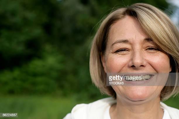 Mature woman smiling at camera, portrait