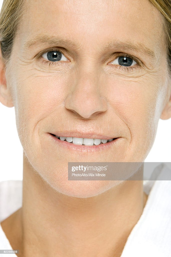 Mature woman smiling at camera, portrait : Stock Photo