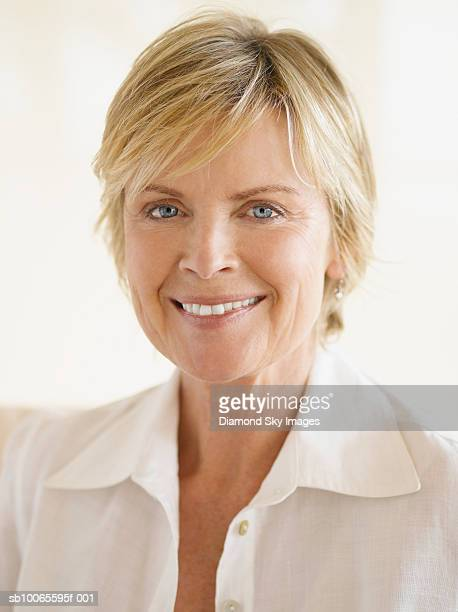 mature woman smiling, indoors, portrait - open blouse stock photos and pictures