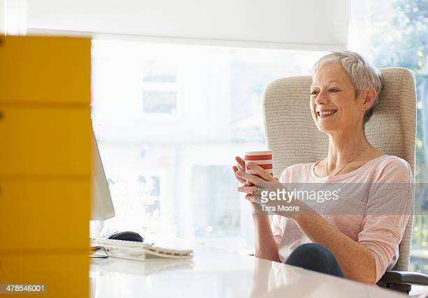 mature woman smiling looking at computer