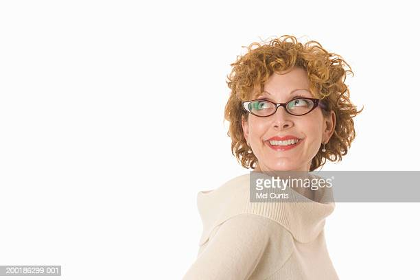 Mature woman smiling, looking up