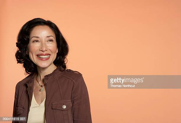 mature woman smiling, looking up - colored background stock pictures, royalty-free photos & images