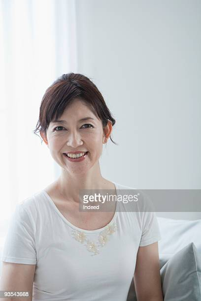 Mature woman smiling on couch