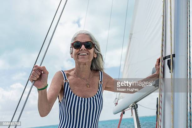 mature woman smiling on sailboat - hot women on boats stock pictures, royalty-free photos & images