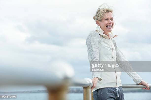 Mature woman smiling outdoors.