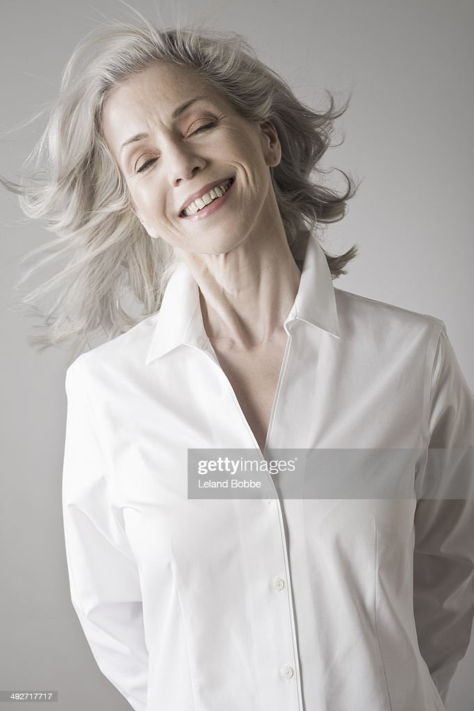 Mature woman smiling : Stock Photo