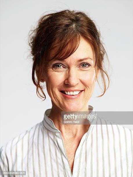 Mature woman smiling, portrait, close-up