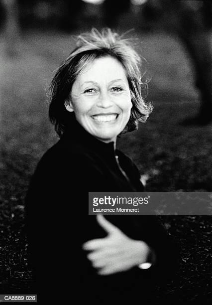 Mature woman smiling, portrait, outdoors (B&W)