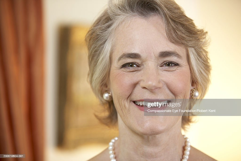 Mature woman smiling, portrait : Stock Photo