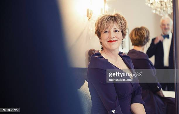 mature woman smiling, portrait - purple dress stock pictures, royalty-free photos & images