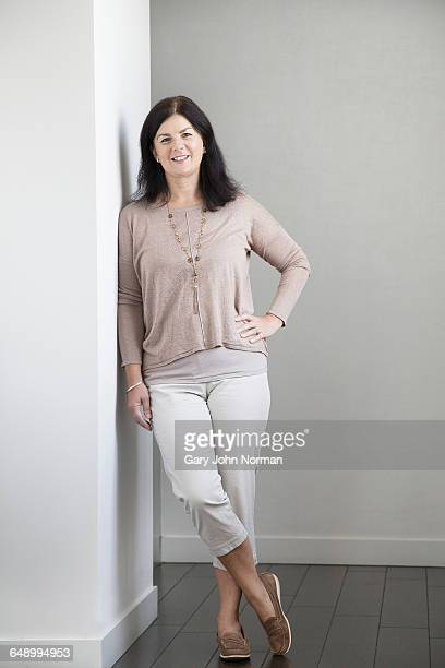 mature woman smiling, portrait - white pants stock pictures, royalty-free photos & images