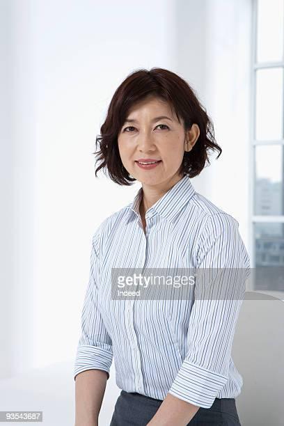 Mature woman smiling, portrait