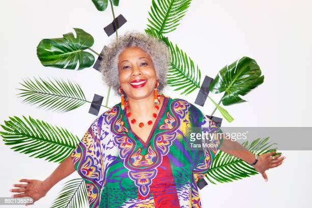Mature woman smiling with leaves