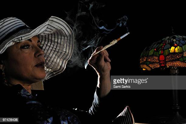 Mature woman smoking with cigarette holder