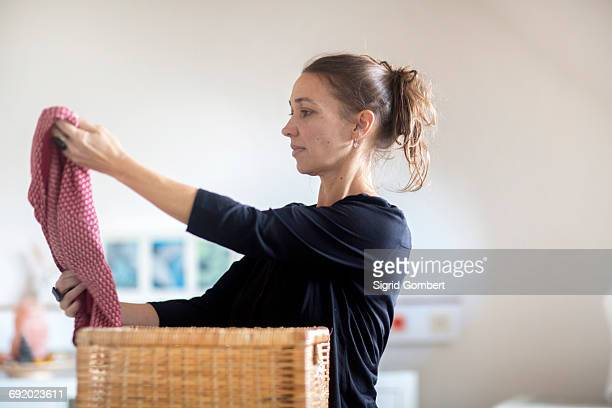 Mature woman sorting through clothes