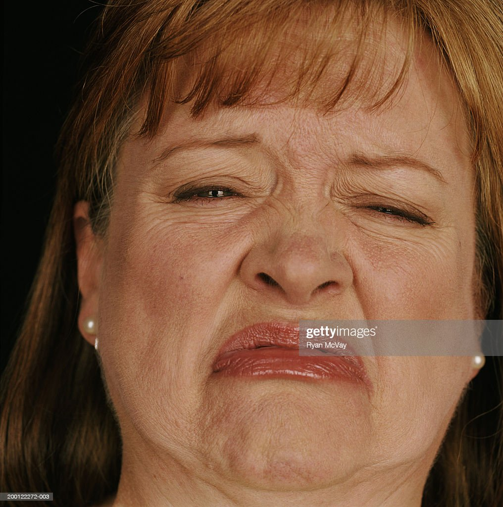 Mature woman squinting eyes and frowning, portrait, close-up : Stock Photo