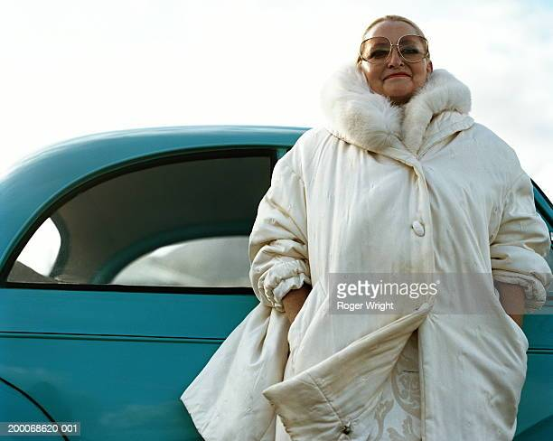 mature woman standing by car, portrait - parka coat stock pictures, royalty-free photos & images