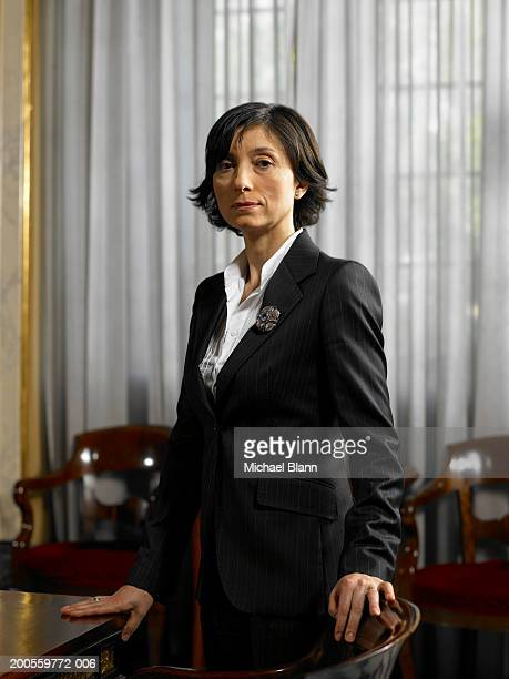 mature woman standing by conference table, portrait - politician stock pictures, royalty-free photos & images