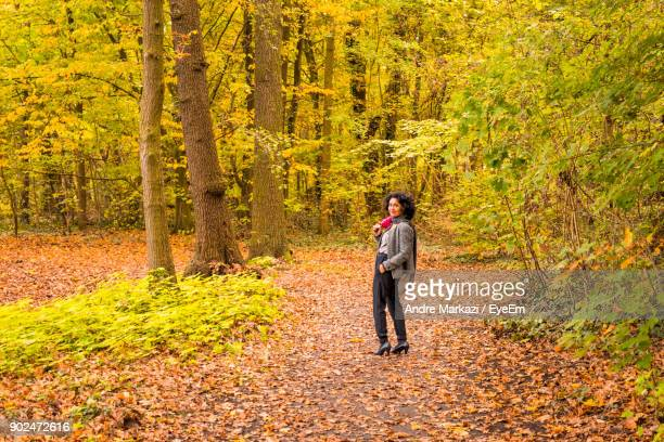 Mature Woman Standing In Forest During Autumn