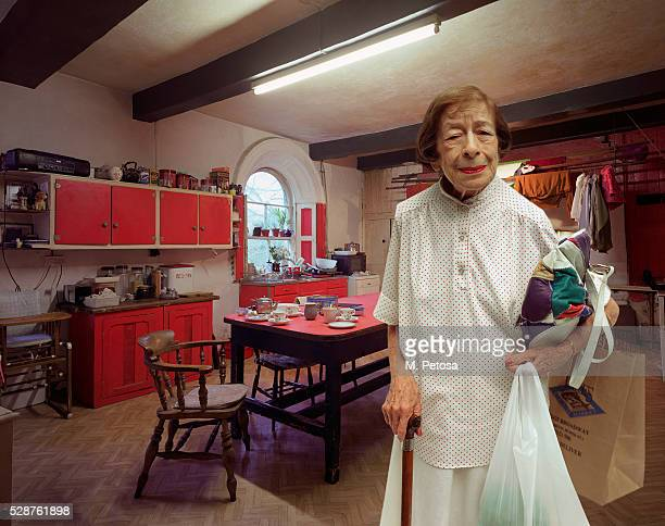 Mature woman standing in kitchen