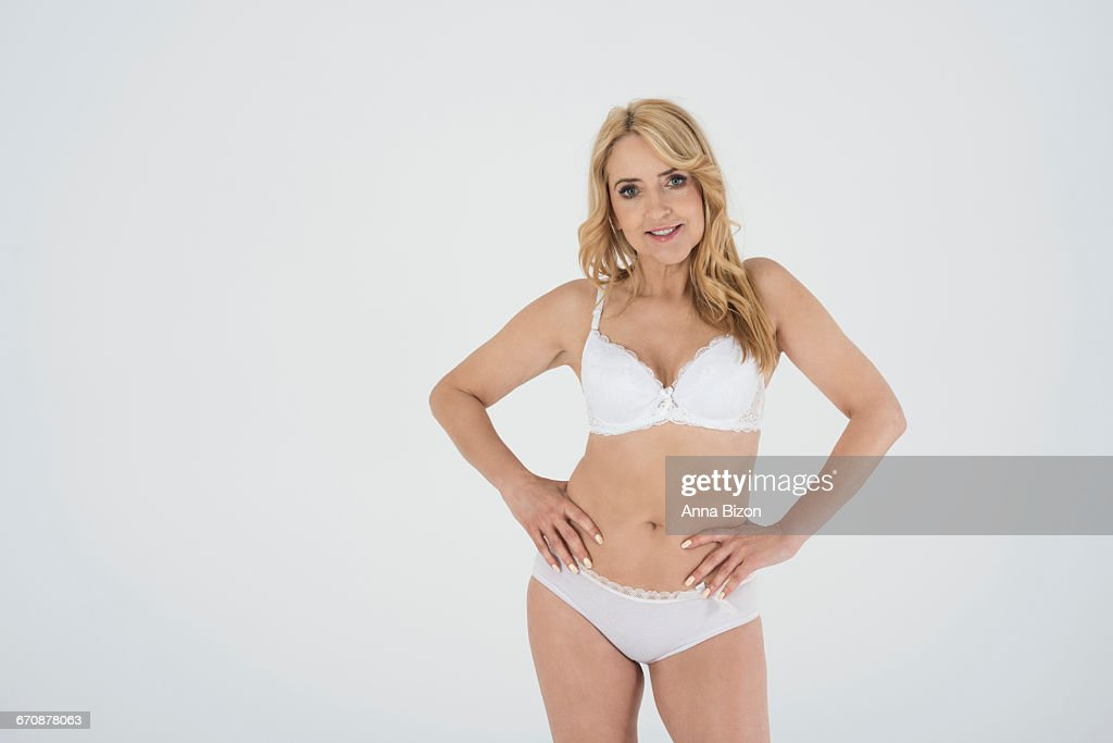 mature woman standing in lingerie debica poland stock photo | getty