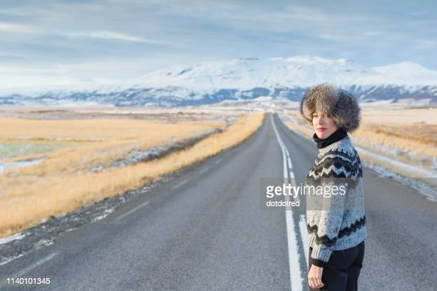 mature woman standing in middle of country road, iceland - mid section stock pictures, royalty-free photos & images