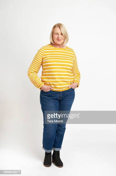 mature woman standing in studio - full length stock pictures, royalty-free photos & images