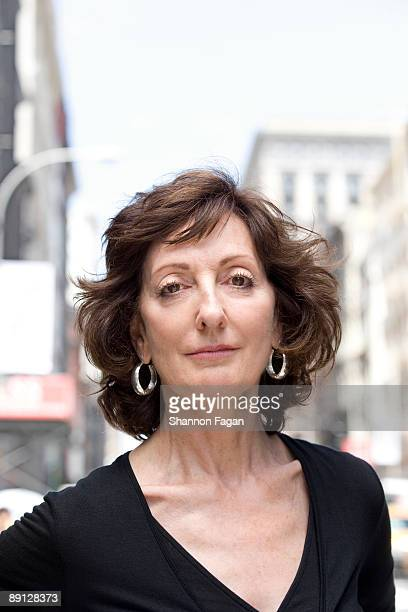 Mature Woman Standing on City Sidewalk