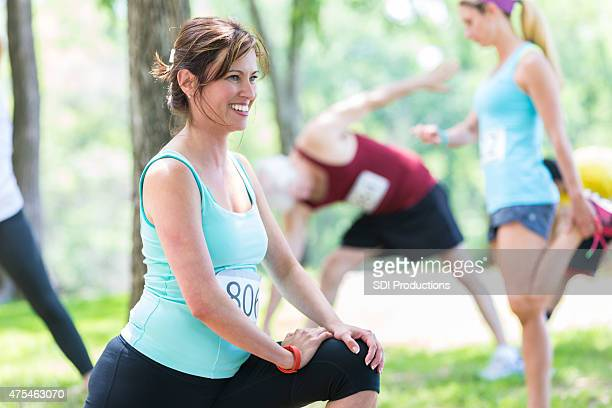 Mature woman stretching before marathon or 5k race.