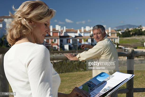 Mature woman studying realestate booklet