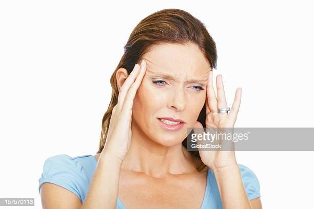 Mature woman suffering from headache