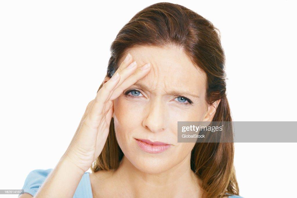 Mature woman suffering from headache : Stock Photo
