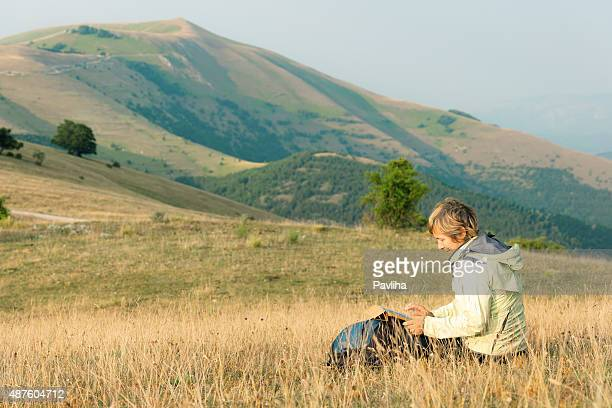 Mature Woman Surfing in Mountains near Castelluccio, Italy