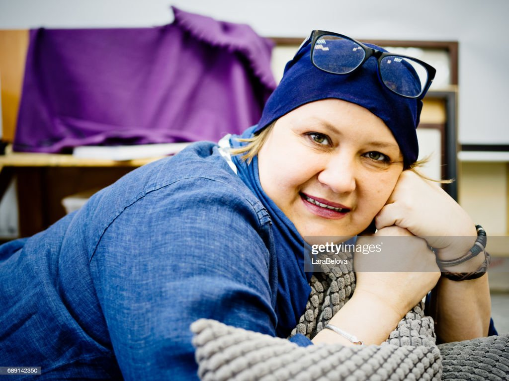 Mature woman takes a rest after moving house : Stock Photo